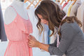 Fashion Designer Measuring Dress On A Mannequin Royalty Free Stock Images - 31447259