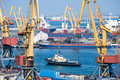 Port With Tug Boat And Ships Stock Images - 31449314