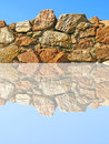 Old Stone Wall Being Reflected In Water. Royalty Free Stock Photo - 31465945