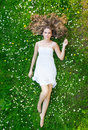 A Young Woman Laying On The Grass In A White Dress Stock Photography - 31466622