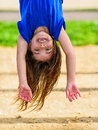 Beautiful Child Hanging Upside And Laughing Stock Photography - 31473102