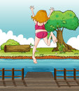 A Girl Jumping At The Wooden Bridge Royalty Free Stock Images - 31479469