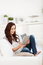Casual Woman Relaxing With A Tablet Stock Image - 31484571