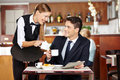 Man In Coffee Shop Flirting With Waiter Stock Photos - 31492953