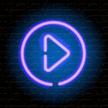 Neon Music Play Button On The Brick Wall Royalty Free Stock Photography - 31494497