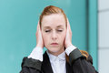 Businesswoman With Eyes Closed Covering Ears Stock Photos - 31499623