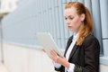 Serious Businesswoman Reading Tablet PC Royalty Free Stock Photo - 31499745