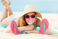Smiling Woman Sunbathing On Beach Royalty Free Stock Photography - 31499927