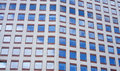 Windows In Office Building Reflecting Blue Sky Royalty Free Stock Photos - 31505688