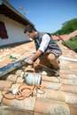 Worker Fixing Gutter On Roof Royalty Free Stock Photo - 31545875