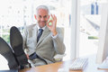Happy Businessman Giving Ok Sign With Feet Up Stock Photography - 31552482