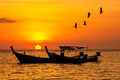 Silhouette Small Fishing Boat With Birds And Sunsets Royalty Free Stock Photography - 31567447