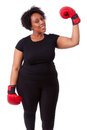 Overweight Young Black Woman Holding Boxing Gloves - African Peo Royalty Free Stock Photos - 31596538