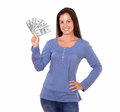 Hispanic Woman Holding Dollars While Standing Royalty Free Stock Photo - 31609085