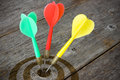 Darts Hitting  Target On A Wooden Planks Stock Photos - 31624153