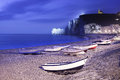 Etretat Village, Bay Beach And Boats On Foggy Night. Normandy, France. Stock Images - 31630544