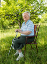 Old Woman Sitting On A Chair Stock Image - 31634671