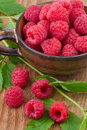 Fresh Raspberry In Cup On Wooden Table Royalty Free Stock Photography - 31642297