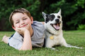 Child Playing With His Pet Dog Stock Photography - 31649972