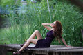 Young Asian Woman Posing In Greenery Background Stock Image - 31660801