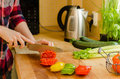 Woman S Hands Cutting Tomato On The Kitchen, Other Fresh Vegetab Royalty Free Stock Photography - 31662597