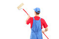 Man In A Uniform Painting A Wall Stock Images - 31669004