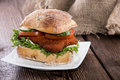 Chicken Schnitzel On A Roll Stock Images - 31674614