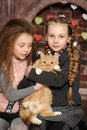 Two Sister Girls With A Cat Stock Photos - 31695333