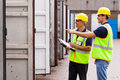 Workers Checking Containers Royalty Free Stock Image - 31712136
