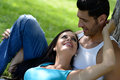 Happy Smiling Couple Laying On Green Grass Stock Photo - 31760550
