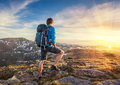 Backpacker On Top Of A Mountaine Stock Photos - 31762033