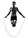 Young Man Exercising Jumping Rope Silhouette Stock Photo - 31788090