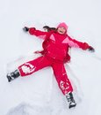 Little Girl Laying In Star Shape In Snow Royalty Free Stock Image - 31796016