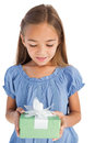 Cute Little Girl Holding A Wrapped Gift Stock Image - 31801431