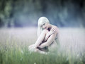 Young Sexy Woman Sitting On Meadow Royalty Free Stock Photos - 31822248