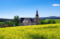 Church On The Colza Field Royalty Free Stock Photography - 31835017