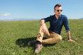 Casual Man In The Grass Looks Away Stock Photo - 31846340