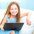 Little Cute Girl With A Laptop Stock Images - 31854814