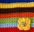 Part Of Colorful Knitted Wool With Knitted Flower Royalty Free Stock Images - 31863129