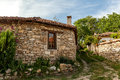 A Stone Wall And An Old House From Arbanasi, Bulgaria. Stock Photos - 31892173