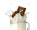 Two Chocolate Blocks Falling Into A Glass Mug Full Of Fresh Milk. Royalty Free Stock Images - 31912489