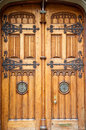 Old Wooden Doors With Brass Fixtures Stock Photography - 31924932