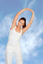 Pretty Woman Doing Stretching Into Her Workout Stock Image - 31944101