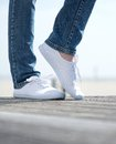Woman Legs In Comfortable White Shoes Standing Outdoors Stock Photo - 31980170