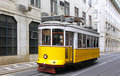 Typical Yellow Tram On The Street Of Lisbon Royalty Free Stock Photo - 31993255