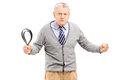 Angry Mature Man Holding A Belt And Posing Stock Images - 31994314