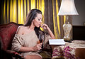 Beautiful Sexy Woman With Glass Of Wine Reading A Book Sitting On Chair Royalty Free Stock Photography - 32015457