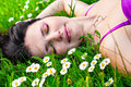 Young Woman Lying In Grass With Flowers Royalty Free Stock Images - 32019829