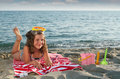 Little Girl With Diving Mask Lying On Beach Stock Image - 32024311