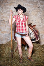 Cowgirl With Hay Fork Stock Images - 32029324